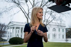 Trump adviser Kellyanne Conway gets ready to go on television outside the White House, Sunday, Jan. 22, 2017, in Washington. (AP Photo/Manuel Balce Ceneta)