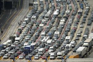 Vehicles queuing at the Port of Dover, southern England, as motorists face continued disruption traveling to France, Sunday July 24, 2016.  Holiday makers and commercial traffic all face misery on the roads with some people forced to spend the night in their cars after getting stuck in jams leading to the port, as French border officials enforce security checks during the state of emergency following recent extremist attacks. (Yui Mok / PA via AP)