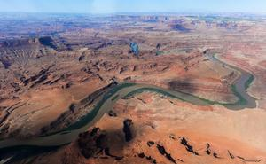 FILE - This May 23, 2016, file photo, shows the northernmost boundary of the proposed Bears Ears region, along the Colorado River, in southeastern Utah. Interior Secretary Ryan Zinke is recommending that six of 27 national monuments under review by the Trump administration be reduced in size, along with management changes to several other sites. A leaked memo from Zinke to President Donald Trump recommends that two Utah monuments — Bears Ears and Grand Staircase Escalante — be reduced, along with Nevada's Gold Butte and Oregon's Cascade-Siskiyou (Francisco Kjolseth/The Salt Lake Tribune via AP, File)