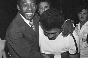 Pele is shown with fellow Brazilian soccer player Garrincha at the Museum of Modern Art in Rio de Janeiro, Dec. 20, 1973. (AP Photo). Keywords: Smiling Professional Sportsperson Arm Around Standing Mischief