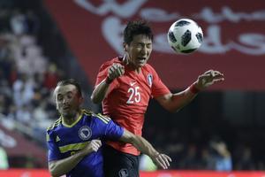 Sydkoreas Jung Woo-young i aktion mod Bosnien for to uger siden - med nummer 25 på trøjen. Ved VM spiler han med nummer 15.
