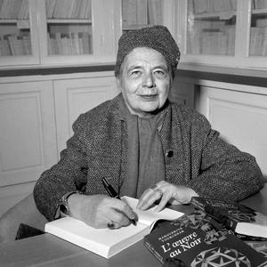 """French writer Marguerite Yourcenar signs her book """"L'oeuvre au noir"""" awarded with the Femina prize in Paris on November 26, 1968. AFP PHOTO"""
