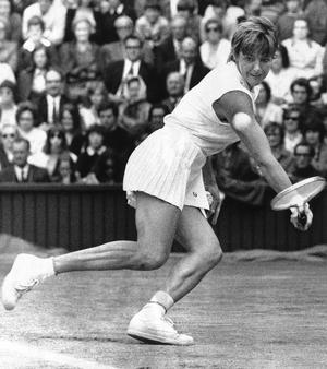 Australia's Margaret Court beats the U.S.'s Billie Jean King to win the women's singles title in a long battle on the Centre Court in Wimbledon, London, July 3, 1970. She won 14-12, 11-9. (AP Photo/Press Association)