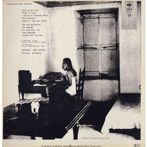 Marianne Ihlen ved Cohens skrivemaskine. Fra bagsiden af albummet 'Songs from a Room'.