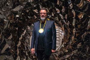 """Icelandic/Danish artist Olafur Eliasson poses for a photograph beside his art installation titled """"Your Spiral View"""" during a press-preview at Tate Modern in London on July 9, 2019. (Photo by Niklas HALLE'N / AFP) / RESTRICTED TO EDITORIAL USE - MANDATORY MENTION OF THE ARTIST UPON PUBLICATION - TO ILLUSTRATE THE EVENT AS SPECIFIED IN THE CAPTION"""