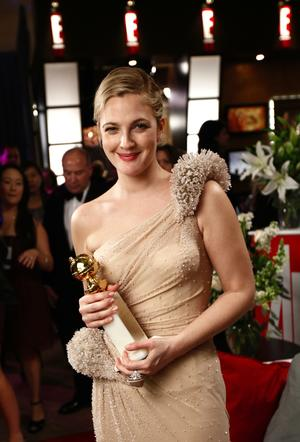 Actress Drew Barrymore stops for a photo backstage after winning the Globe for Best Actress Mini-Series or TV Movie at the 67th Annual Golden Globe Awards on Sunday, Jan. 17, 2010, in Beverly Hills, Calif. (AP Photo/Matt Sayles)