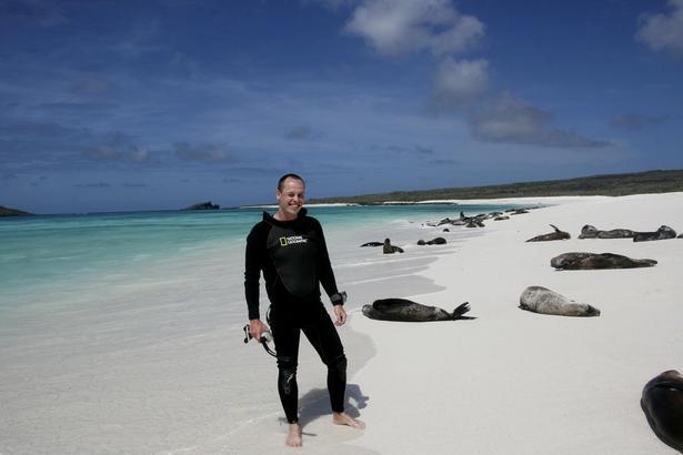 Det store smil kommer uden tvivl frem efter en tur i havet med svømmerfødder og snorkelmaske på.