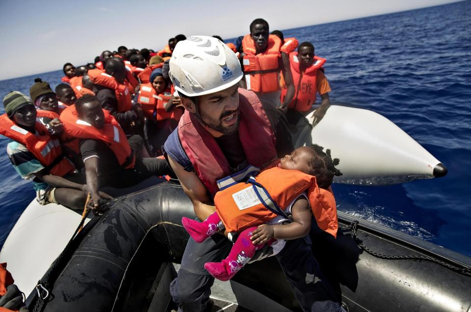 The first people being rescued are normally women, children and the weak. This is Jakob from Hamburg making sure a baby gets on the ship.