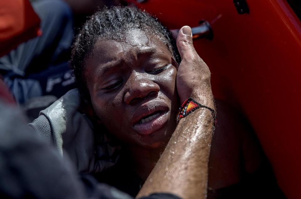 This woman was in the same inflatable boat. She was almost lifeless when the Tornado-team rescued her. The translator Gennaro is taking care of her.