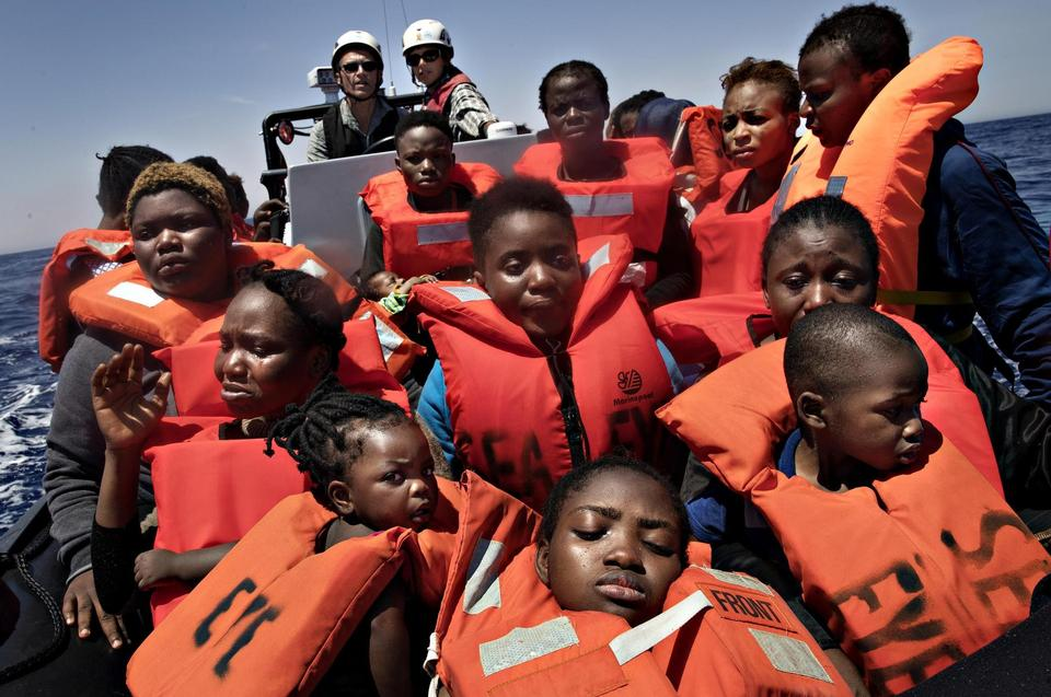 After the refugees have put on life jackets they are tranported to one of the NGO's ships or to a ship from the Italian coastguard. This is Sabine and Florin on the way to 'Sea Wartch 2'.