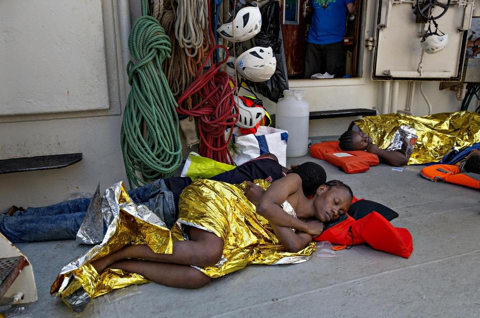 The most exhausted of the refugees are allowed to wait on deck outside the clinic for a doctor to attend them.